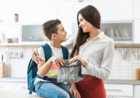 Young-woman-helping-her-son-get-ready-for-school