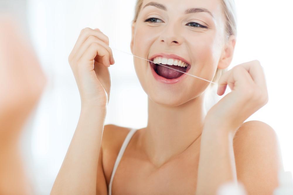 teeth flossing thread for good oral health